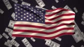 fan of money : Digital animation of an american flag waving against a black background with dollar bills