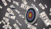 seta : Digital animation of arrows hitting a target on a grey background filled with dollar bills