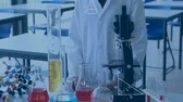 мерный стакан : Digital composite of a chemistry student standing in front of a table with chemicals and equipment and equations running in the foreground
