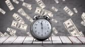 fan of money : Digital animation of an alarm clock with flying money on a brick wall background