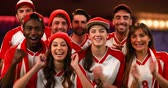 morcego : Front view of a group of fans wearing red and white jerseys cheering 4k Stock Footage