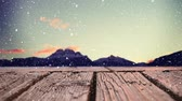 bois : Low angle of a wooden plank viewing a mountain with digital snow