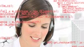 diyalog : Close up of a Caucasian female call centre agent talking on a headset. Digital animation of programming codes are running in the foreground