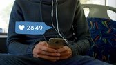 интерактивный : Digital composite of man texting on his phone and beside him is a digital animation of a message bubble with heart icon and a number count up.