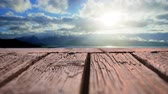bois : Low angle of wooden plank deck with a view of the sunny sky