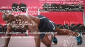 łysy : Digital composite of bald African-american man doing push ups at the gym while interface codes can be seen in the foreground