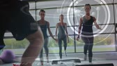 osztály : Digital composite of three women doing aerobics at gym with male instructor. DNA helix and multiple circles with labels are seen in the foreground
