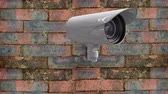 guarda : Digital composite of a moving surveillance camera on a brick wall.