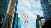 dividir : Digitally generated animation of social media icons moving up with background of the buildings
