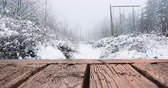 negativnost : Digital composite of a wooden deck while background shows a snowy hill 4k