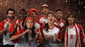 templombúcsú : Digital composite of a group of diverse fans wearing uniforms cheering while confetti fall and fireworks in the background Stock mozgókép