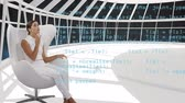serwerownia : Digital composite of a Caucasian woman sitting in a white room while program codes move in the screen