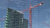kask : Digital animation of binary codes moving in the screen with background of a crane beside a building