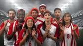sport kleding : Digital composite of a group of diverse fans wearing uniforms cheering in a stadium