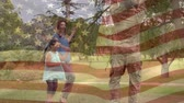 stodola : Digital composite of a Caucasian family reuniting with the father in uniform while American flags waving in the background