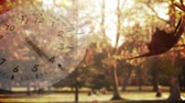 второй : Digital animation of a white clock with moving hands and background of dried leaves falling in a park