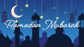 초승달 : Digitally generated animation of a silver glitter Eid Mubarak greeting with a blue  background of mosque silhouettes and black lanterns hanging with yellow stars and crescent moon in white