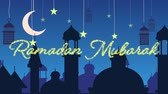 arabesco : Digitally generated animation of a gold glitter Ramadan Mubarak greeting with a blue background of mosque silhouettes and black lanterns hanging with yellow stars and crescent moon in white
