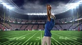 excited : Digital animation of an American football player celebrating on a football field stadium