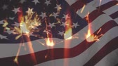полосы : Digital composite of sparklers and an American flag waving in the foreground