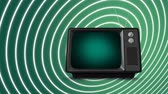 sinema : Digital animation of a television with a green screen is on a spiralling white and green background