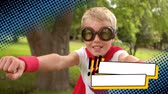 quintal : Close up of a little Caucasian boy wearing a superhero costume pretending to fly in the park with dotted border effect
