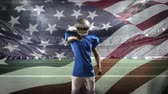 dc : Digital composite of an African-american football player with arms crossed at a field stadium with an American flag waving in the background
