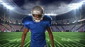 fotbal : Digital animation of an African-american football player taunting on a field stadium background