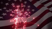 billowing : Digital animation of a fireworks display with an American flag waving in the foreground