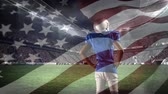ヨーク : Digital composite of an African-american football player standing on the field with an American flag waving in the foreground