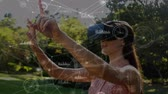 equations : Digital composite of a Caucasian woman wearing a virtual reality headset in their backyard with connected lines and graphs on the foreground Stock Footage
