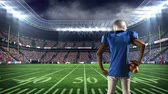 stade : Rear view of an African-american football player standing on the game field Vidéos Libres De Droits