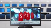 кино : Digital animation of a a flat screen television with a sale tag on its screen. Behind it are other televisions displayed on a wall
