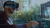 equations : Digital composite of a man wearing a virtual reality headset outdoors with codes running in the foreground