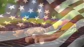 dc : Digital composite of grilling meat and vegetables on a family picnic with an American flag waving the foreground