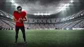 football field : Digital animation of an American football athlete playing with football in a stadium filled with people