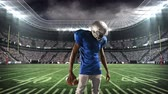 football field : Digital composite of an African-american football athlete limbering up for a game with a background of a stadium