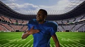 viraj : Close up of an African-american football player on a football stadium field