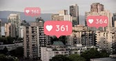 interaktivní : Digital composite of chat boxes with heart icons and numbers counting up on a city background 4k