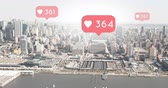 kapcsolat : Digital composite of a wide city view with heart icons increasing in count 4k