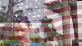 assobio : Digital composite of a female coach blowing a whistle with an American flag in the foreground
