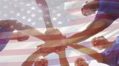행복감 : Digital composite of male and female athletes joining hands with an American flag in the foreground 무비클립