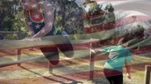 obstacle course : Digital composite of two female athletes running through an obstacle course with an American flag waving in the foreground