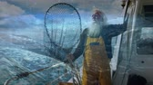 rybolov : Digital composite of an old fisherman holding a large net on a boat with a stormy sea in the foreground