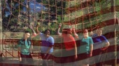 viraj : Digital composite of a group of women standing under a cargo net obstacle course with an American flag waving in the foreground Stok Video