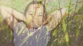 battaniye : Digital composite of a little Caucasian girl lying on a field of grass with tall grass in the foreground