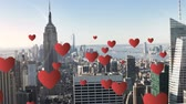 amantes : Digital composite of a city with tall buildings and hearts flying in the foreground