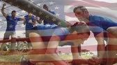 obstacle course : Digital composite of a man assisting a woman crawl under a net while others cheer for her. American flag is waving in the foreground