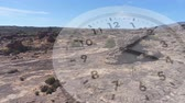 аналог : Digital composite of a rocky plain with little vegetation. Analogue clock is running in the foreground