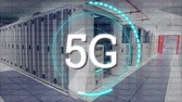 web server : Digital animation of 5G written in the middle of a futuristic circle and a background of a corridor of server towers Stock Footage